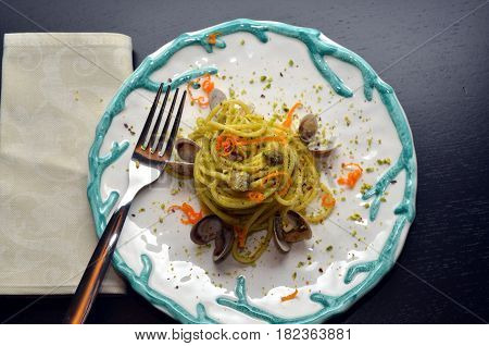 Dish of Spaghetti with seafood and pistachios. Typical Sicilian cuisine, the tradition of the Mediterranean diet