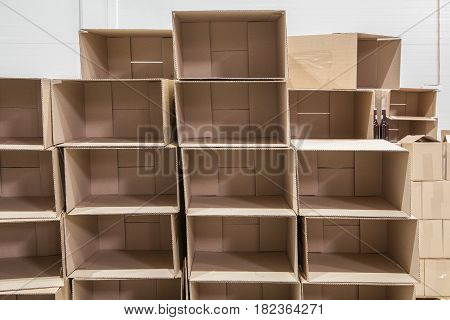 Opened empty brown cardboard boxes in storehouse