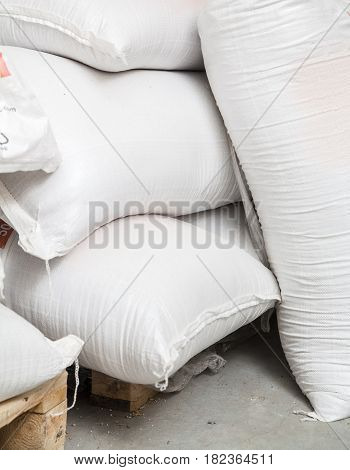 Bags with malt in storehouse on beer production