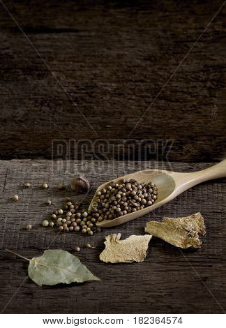 Spices and herbs on old kitchen table. Food and cuisine ingredients.