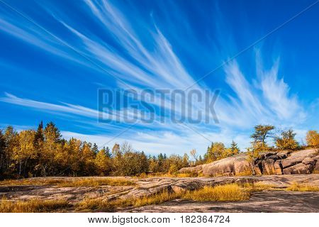 Walk on the park in warm silent day. The concept of ecological and recreational tourism. Cirrus clouds  in Pinawa Provincial Heritage Park