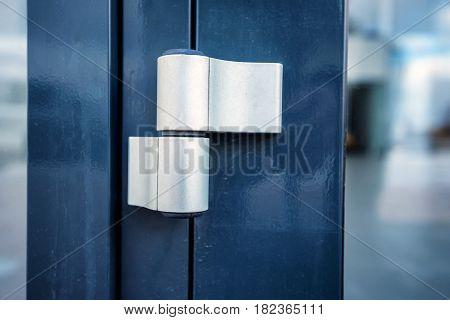 Close-up new modern stylish door hinge on office door.