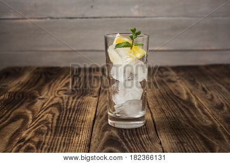 Clear Glass With Cubes Of Ice Lemon And Mint