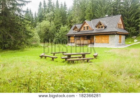 Podbanske Slovakia - August 16 2014: Cottage and a place to sit by the fire in the glade among the forest.