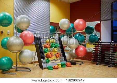Gym room with equipment for fitness.