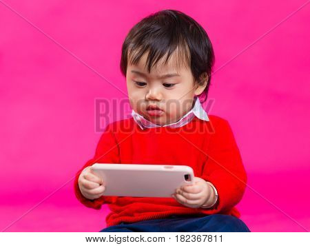 Little boy play with cellphone