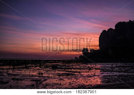 Sunset on a Krabi beach during outflow.
