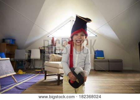 Portrait Of Boy Dressing Up As Pirate In Playroom