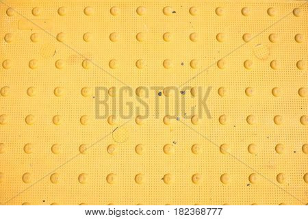 Yellow Background with textured surface of circles