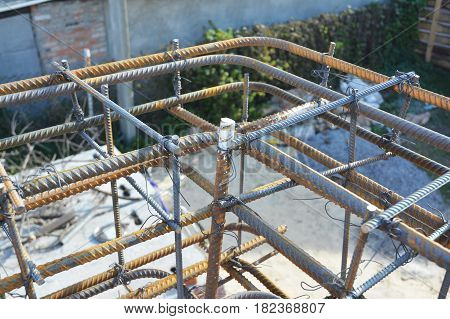 Metal rod construction. Iron Bar house corner building construction. Steel rebar deformed steel bar iron bar for construction.