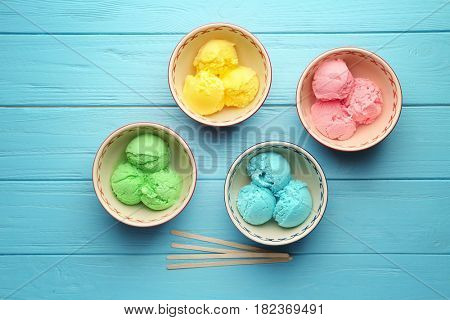 Ice cream collection in bowls on wooden background