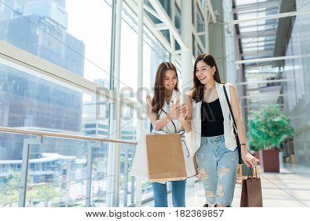 Young girls walking in shopping center