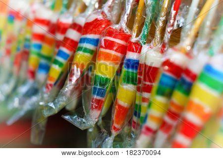 umbrella lollipop on colorful background