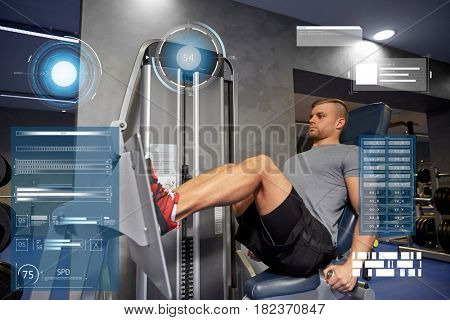 sport, fitness, bodybuilding and people concept - man exercising and flexing leg muscles on gym machine over virtual charts