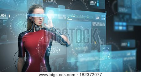 augmented reality, technology, business, future and people concept - woman in virtual glasses and microchip implant or sensors looking at screen projections over dark background