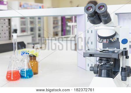 Laboratory Microscope and Scientific equipment. Scientific research background.