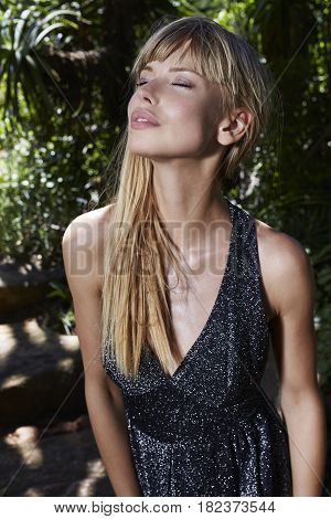 Sensuous young blond woman in high fashion eyes closed