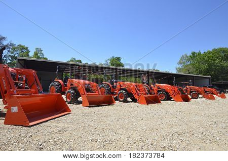OAK RIDGE, LOUISIANA, April 8, 2107: The line of  tractors are  products of Kubota Corporation, a tractor and heavy equipment manufacturer based in Osaka, Japan, established in 1890.