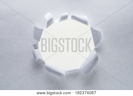 Hole on a paper. White background.