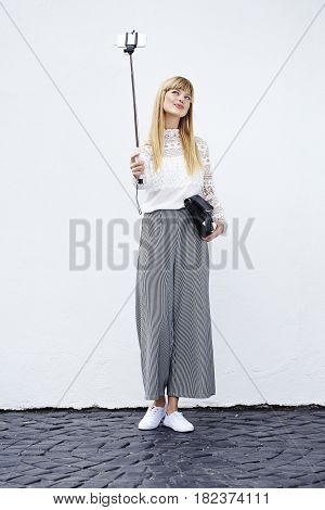 Beautiful model in culottes posing for selfie