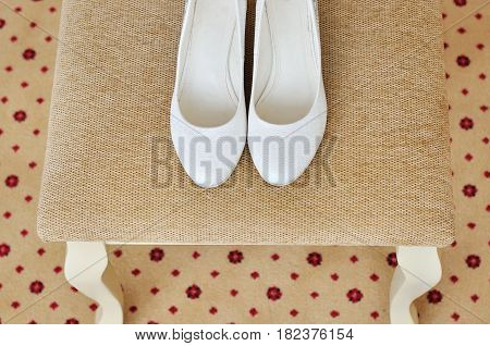 Closeup of a classic pair of white high heel womens shoes. Top view.