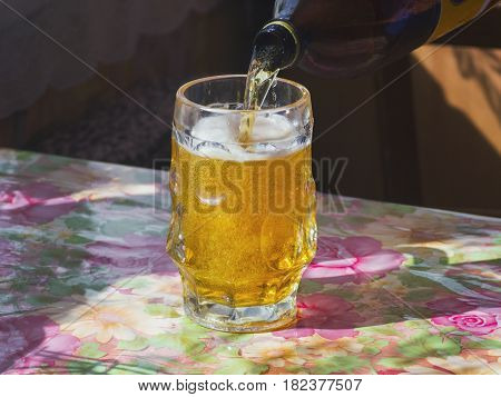 glass of fresh lager beer on the table
