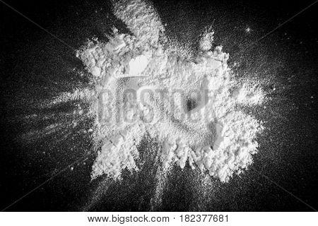 White powder on a black background