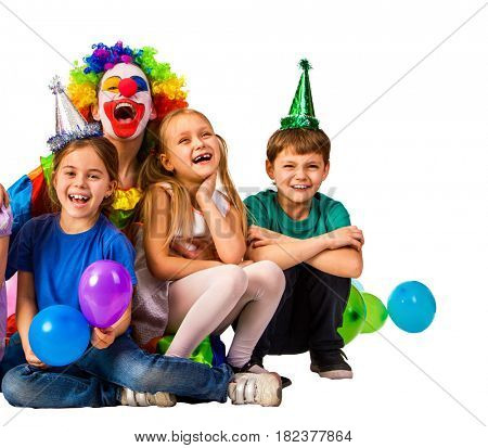 Birthday child clown in wig playing with children. Kid holiday balloons celebratory in hands of events organizer man. Fun of group people pose for camera on white background isolated.