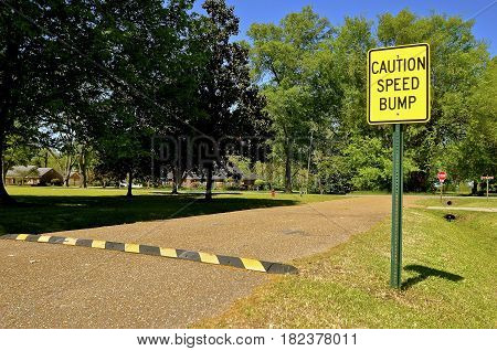 A sign in a small rural town warns motorists of a speed bump