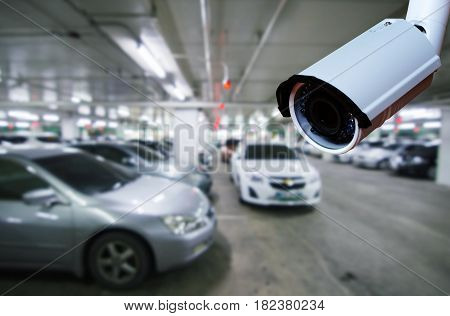 cctv security camera on blurred background of indoor car park security technology concept.