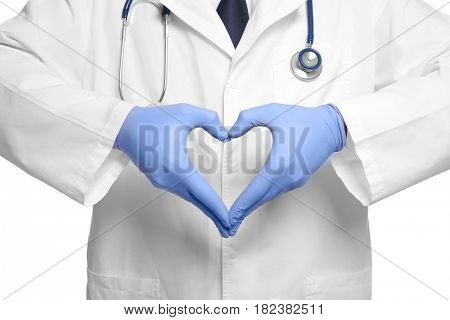 Doctor making heart with his hands on white background