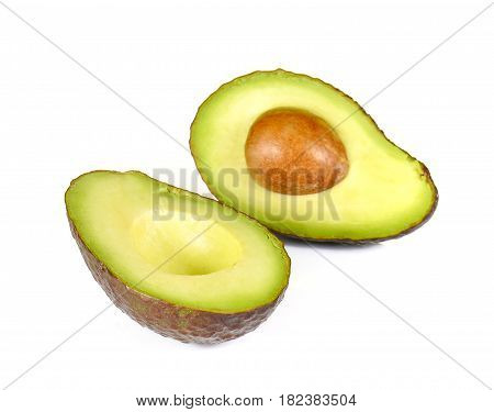 Avocados dark brown cut half isolated on white background.