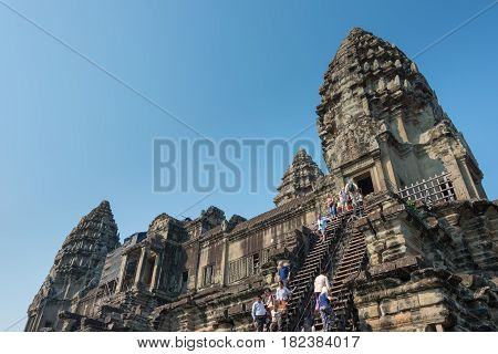 Siem Reap, Cambodia - Feb 5 2015: Visitors At Angkor Wat. A Famous Historical Site(unesco World Heri