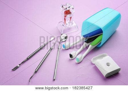 Dental instruments and set for teeth treatment on color background