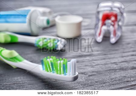 Toothbrush on wooden background, closeup