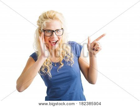 Woman pointing with finger at something with surprise