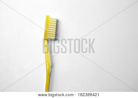 New toothbrush on white background