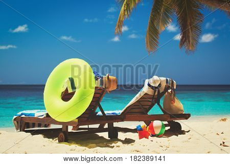Two beach chairs on tropical vacation, beach vacation