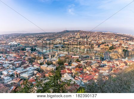 Panorama of Tbilisi, Georgia in sunset rays. Vivid, saturated, splittoned image.