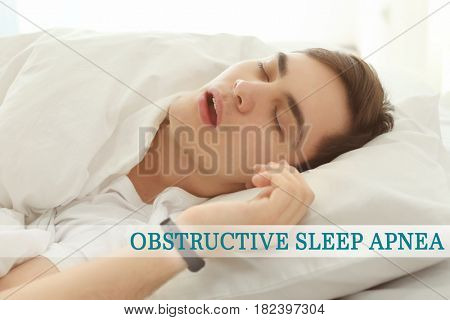 Obstructive sleep apnea concept. Young man snoring while sleeping