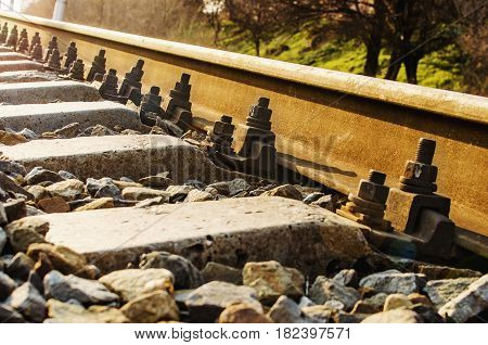 Railroad in motion at sunset. Railway station with motion blur effect Industrial concept background. Railroad travel railway tourism. Blurred railway. Transportation. Shallow depth of field