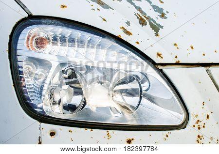 Big Headlight of an old rusty car