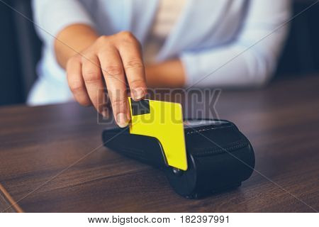 Female Hands Using Payment Terminal Paying With Credit Card, Toned