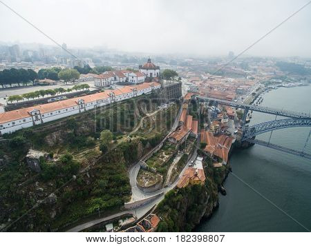 Panoramic view of the old city of Porto. One flew over the roofs of the houses, a river and a bridge. 2016 09