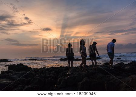 Girls Boys Silhoueted Sunrise Ocean
