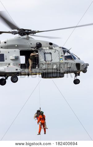 GILZE RIJEN NETHERLANDS - JUNE 21 2014: Rescue operation by a Royal Netherlands Navy NH90 helicopter.
