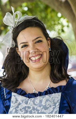 CAGLIARI, ITALY - May 29, 2016: Sunday at La Grande Jatte VIII Ed. At the Public Gardens - portrait of a beautiful smiling woman in Victorian costumes - Sardinia