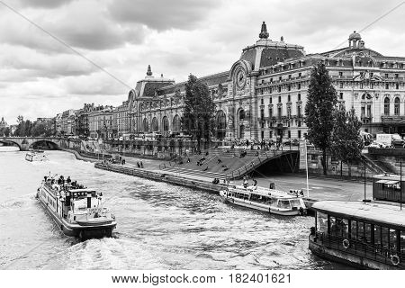 Paris France - July 02 2016: The musee d'Orsay is a museum in Paris on the left bank of the Seine. Musee d'Orsay has the largest collection of impressionist paintings in the world. Black and white.