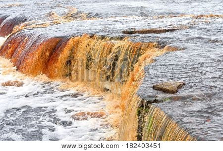 Small waterfall on Tosna River in Leningrad Region Russia.