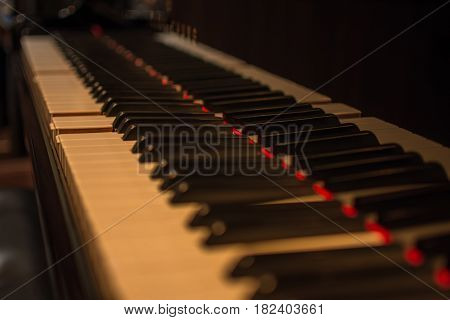 Piano keys on black classical grand piano play a classic song